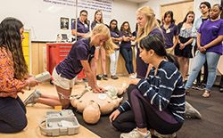 Students performing CPR as part of the Discovery Program.