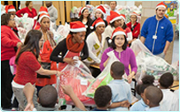 Employees distribute holiday gifts