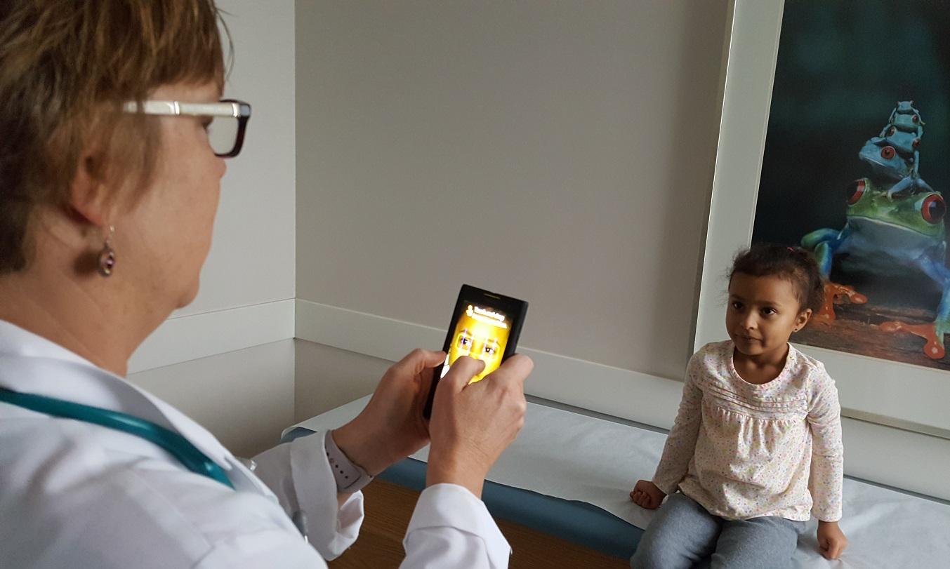 Dr. Karen Judy uses photoscreening to check a patient for potential vision problems during a wellness visit at the Northwestern Medicine Regional Medical Group