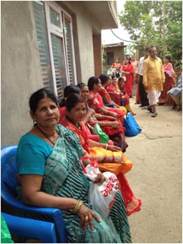 Women Sitting in Chairs in Nepal