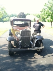 Paul Orednick standing next to a vintage car
