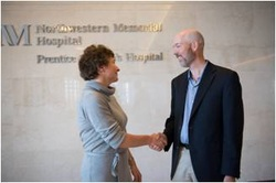 Paul Ruby shaking hands with a Northwestern Medicine doctor