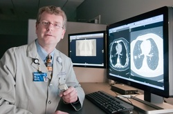 Eric Hart, MD viewing CT scans of the lung