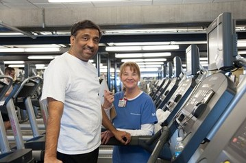 Amar Vakil exercising with a nurse by his side