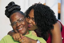 Daughter wraps arms around her mother