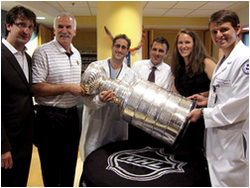 Blackhawks Physician Team Holding The Trophy