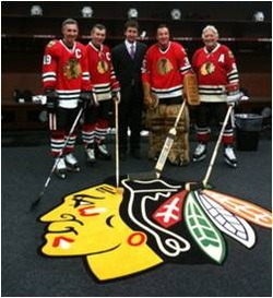 Team physician with Blackhawks players inside the locker room