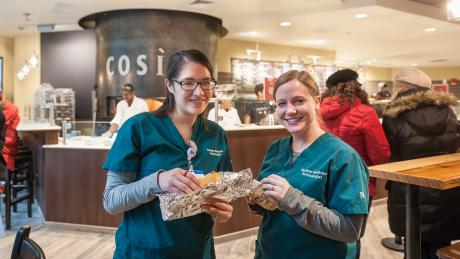 Two Northwestern Medicine employees enjoying sandwiches at new Cosi restaurant