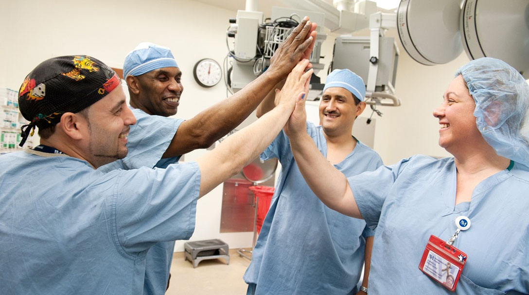 Surgery team giving each other high fives