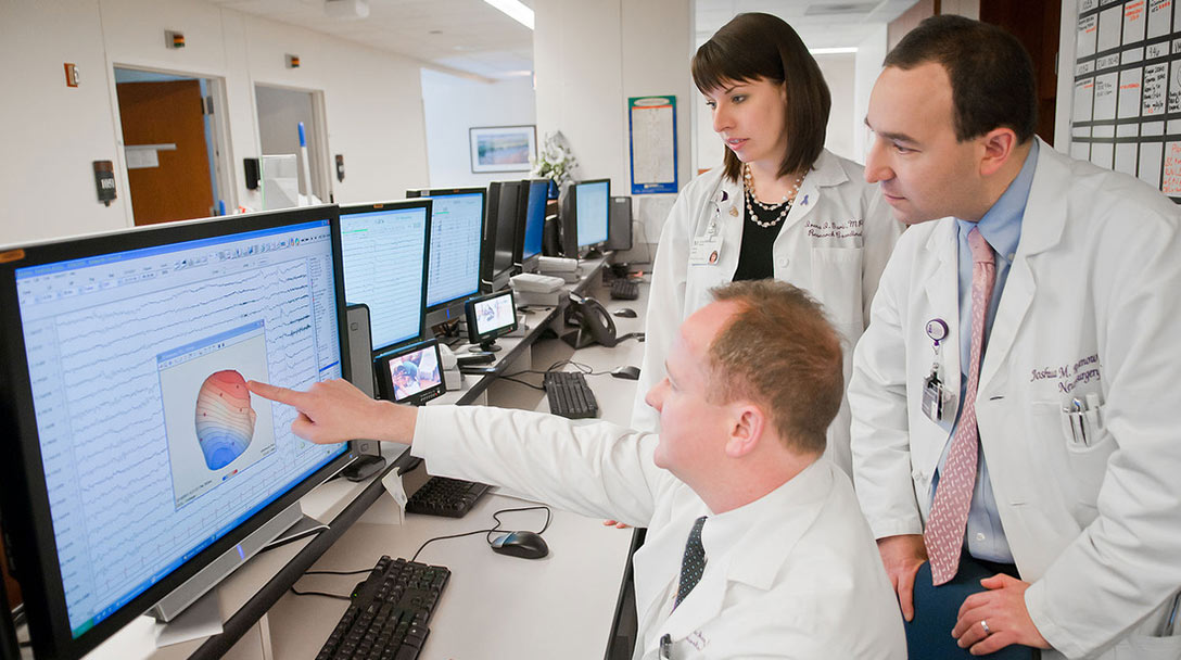 Team of Neurosurgeons viewing a monitor