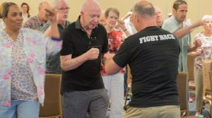 Parkinsons patients take exercise clases to improve balance stability and endurance
