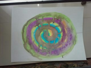 Child's drawing of a colored spiral