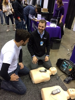 CCARES members set up two mannequins and trained attendees how to do chest-only compression