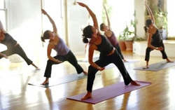 Women performing Yoga exercises
