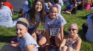 Girls smile for camera at Ryan's Run 5K run or walk