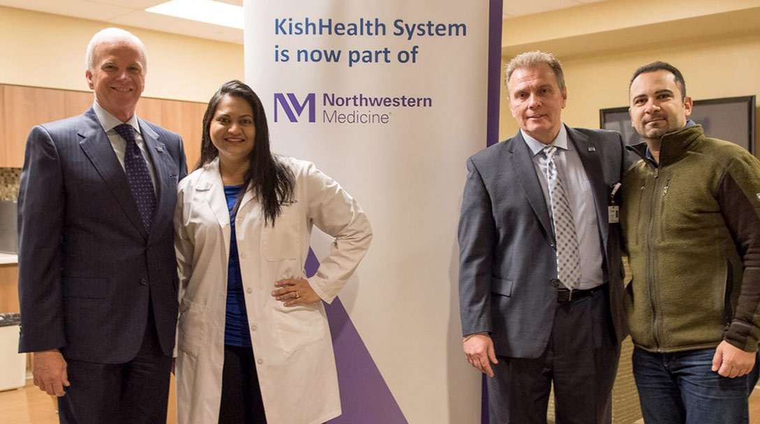 Northwestern Medicine leaders standing with a KishHealth doctor