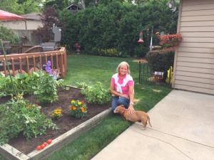 Northwestern patient, Lynn Stanczak in the backyard with her dog