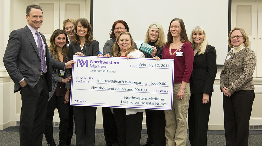 Staff poses with a donation check