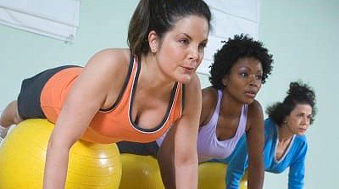 women-using-exercise-balls-fitness-group