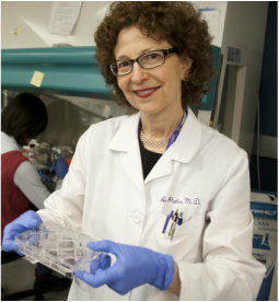 Amy Paller, MD, holding a test kit