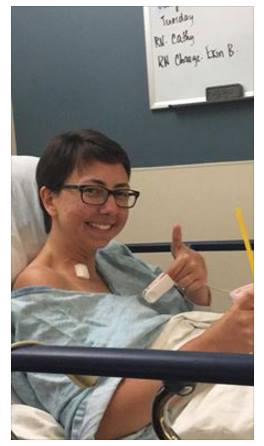 Elise Boni gives a thumbs-up while recovering from a stroke