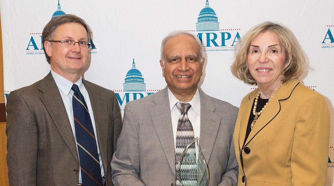 Dr. Noel Rao receiving the AMPRA Leadership Excellence Award