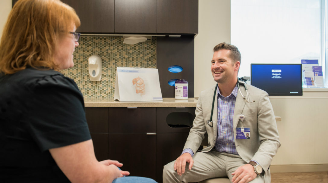 Matthew R. Pittman, MD, medical director of Weight Management and Bariatric Surgery at Northwestern Medicine Delnor Hospital, discusses bariatric surgery with a patient