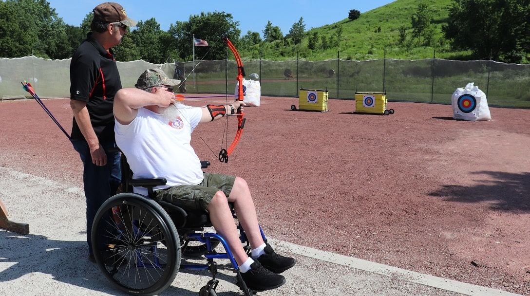 Spinal cord injury support group members enjoy archery during the Marianjoy Rehabilitation Hospital adaptive sports day