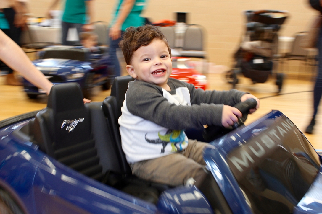 Mateo Fernandez of Lemont, Illinois, drives his new car at Marianjoy