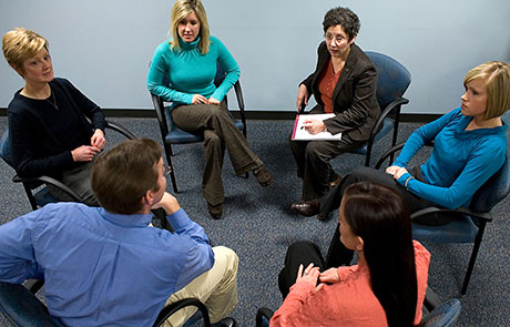 Support group having a group discussion about substance abuse