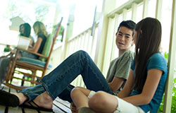 Teens talking sitting on porch