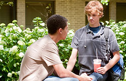 Teens talking outside