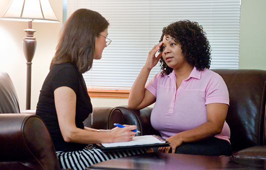 Women discusses serious crisis stabilization with her therapist