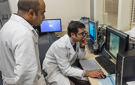 Two physicians reviewing the scan of a patient in the pancreaticobiliary program at Northwestern Memorial Hospital.