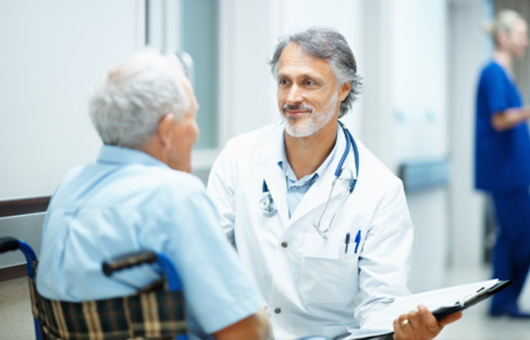 Physician talking with digestive health patient