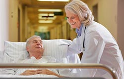 Physician helping senior patient
