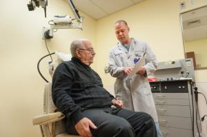 Physician reviewing results with a patient who is seated.