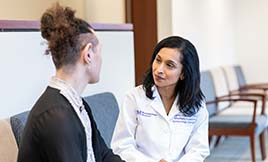 Dr. Angela Chaudhari talking with a gender pathways patient.