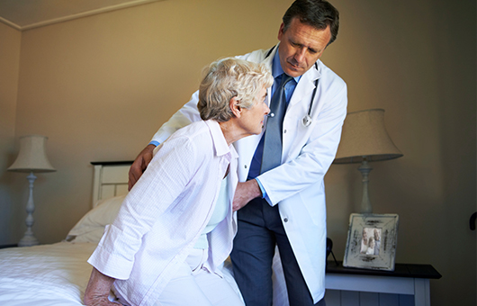 Doctor assisting a patient in hospice