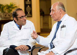 Two physicians with the Movement Disorders Centers of Excellence in discussion.