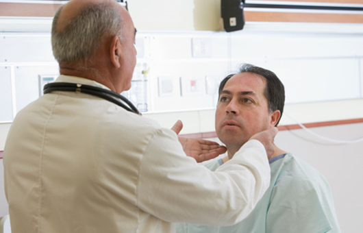 Doctor feeling patient nodes under neck, cranial base tumors
