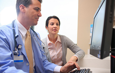 Doctor looking at scan for Cranial Base Tumors