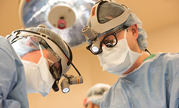 Northwestern Medicine physician Dr. Tyler Koski performing neurosurgery.