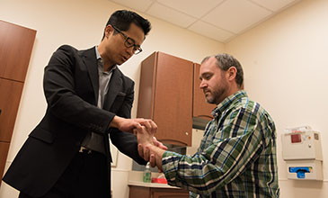 Northwestern Medicine physician Dr. Wellington Hsu examining a patient