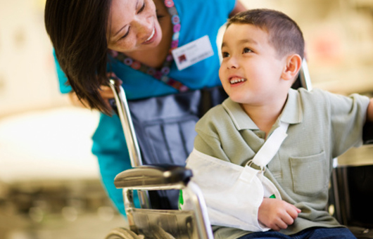 Northwestern Medicine boy leaving hospital with a broken arm in a wheelchair