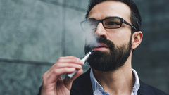 Man with beard smoking E Cigarette