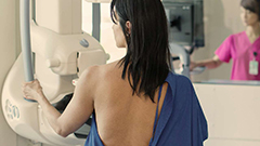Woman receiving a mammogram.