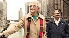 older woman and man site seeing in city