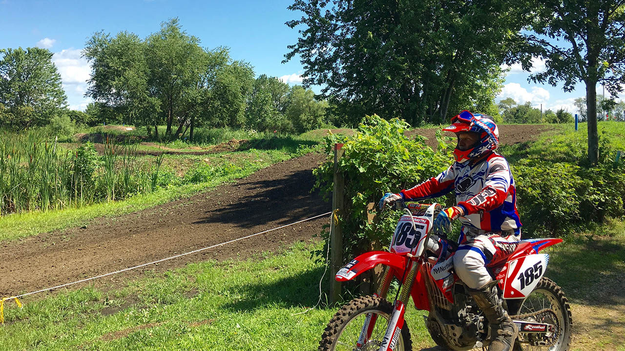 nm-motorcross-racer-celebrates-victory_feature