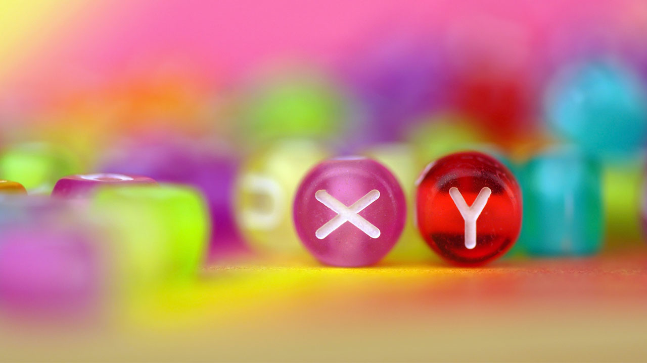 Two beads, one with an X and the other with a Y